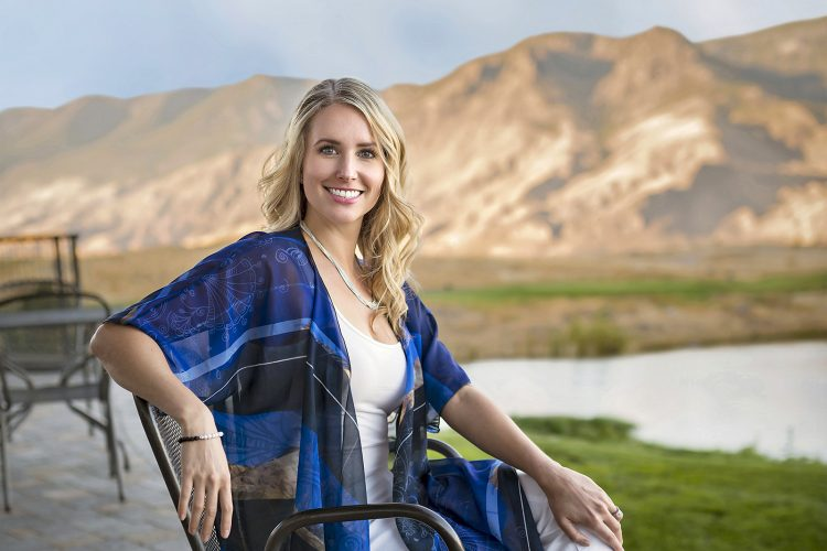 A beautiful woman poses during a commercial fashion shoot for lifestyle active wear at sunset near Kamloops, British Columbia, Canada