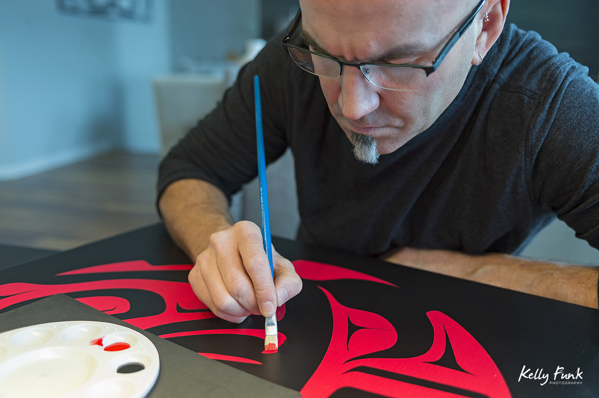 A Kamloops artist works on one of his First Nation paintings, British Columbia, Canada