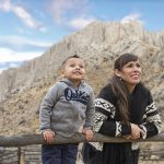 A mother looks skyward with her smiling son during a family shoot, near Kamloops, British Columbia, Canada
