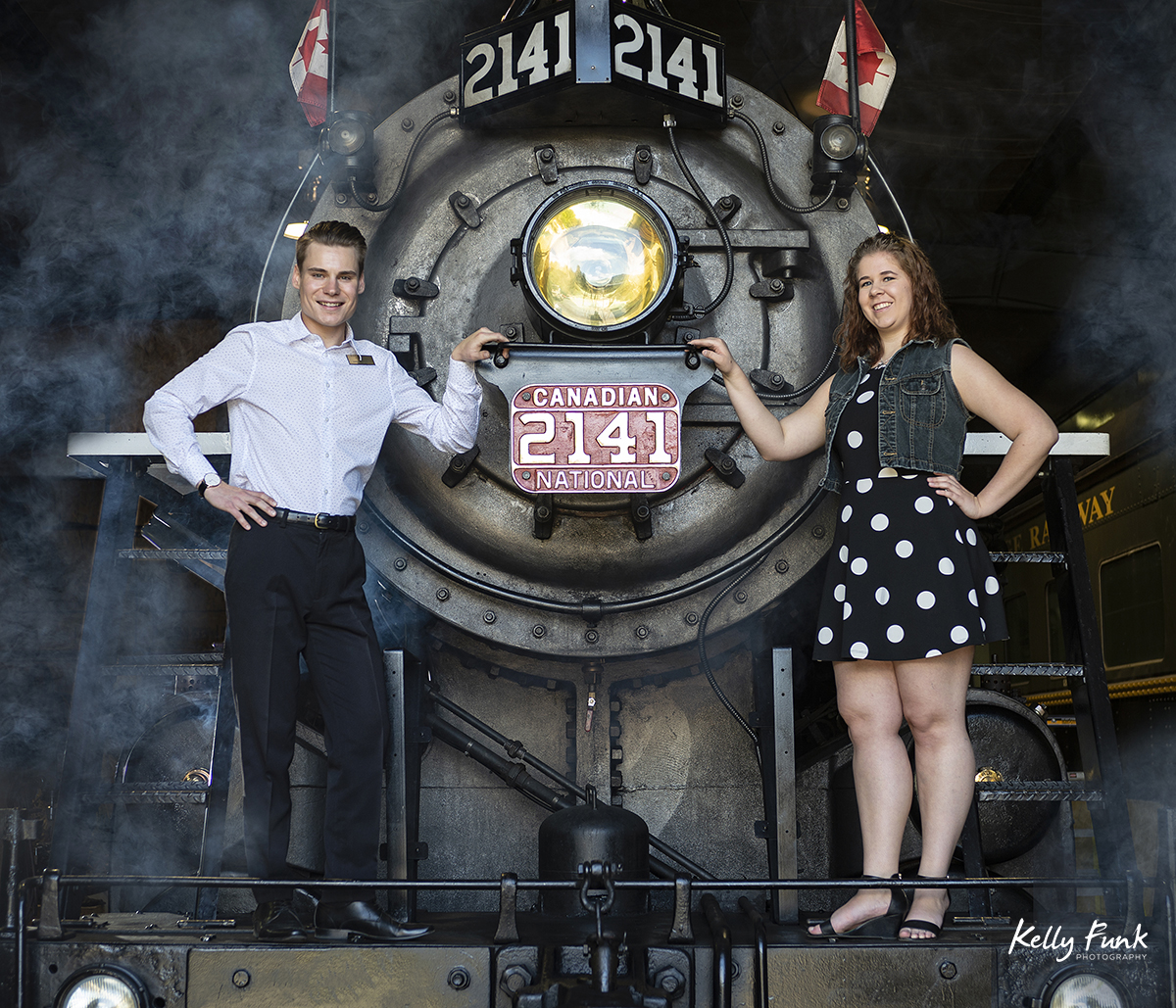 employees of the Kamloops Heritage railway pose during shooting for the 2019 Kamloops fire fighters calendar, Thompson Okanagan region, British Columbia, Canada