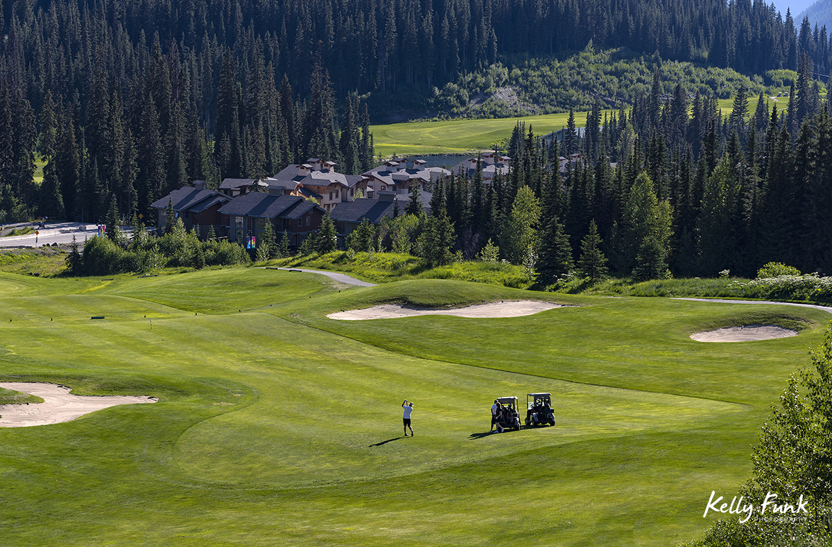 A trio of golfers navigate the 16th hole at the Sun Peaks Resort golf course, north east of Kamloops, British Columbia, Thompson Okanagan region, Canada