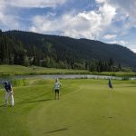 A couple putts on a front nine green at the Sun Peaks Resort golf course, north east of Kamloops, British Columbia, Thompson Okanagan region, Canada