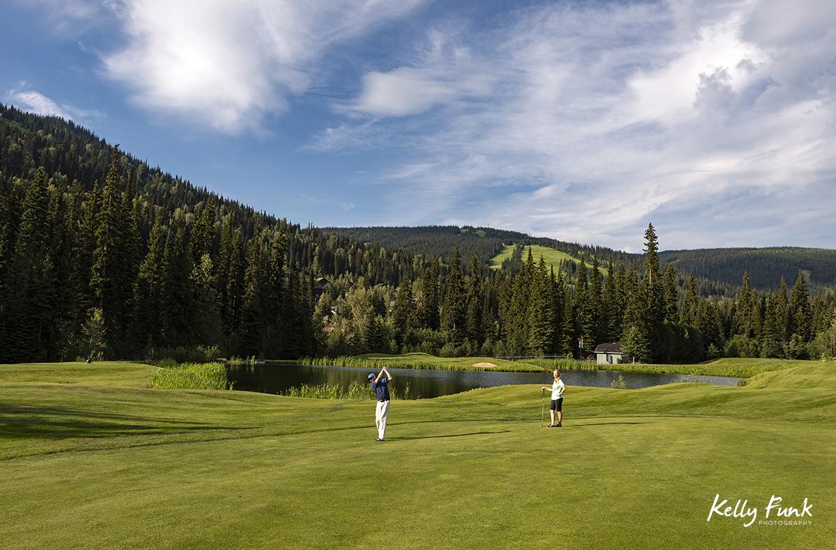 A man hits a fairway shot at the Sun Peaks Resort golf course, north east of Kamloops, British Columbia, Thompson Okanagan region, Canada
