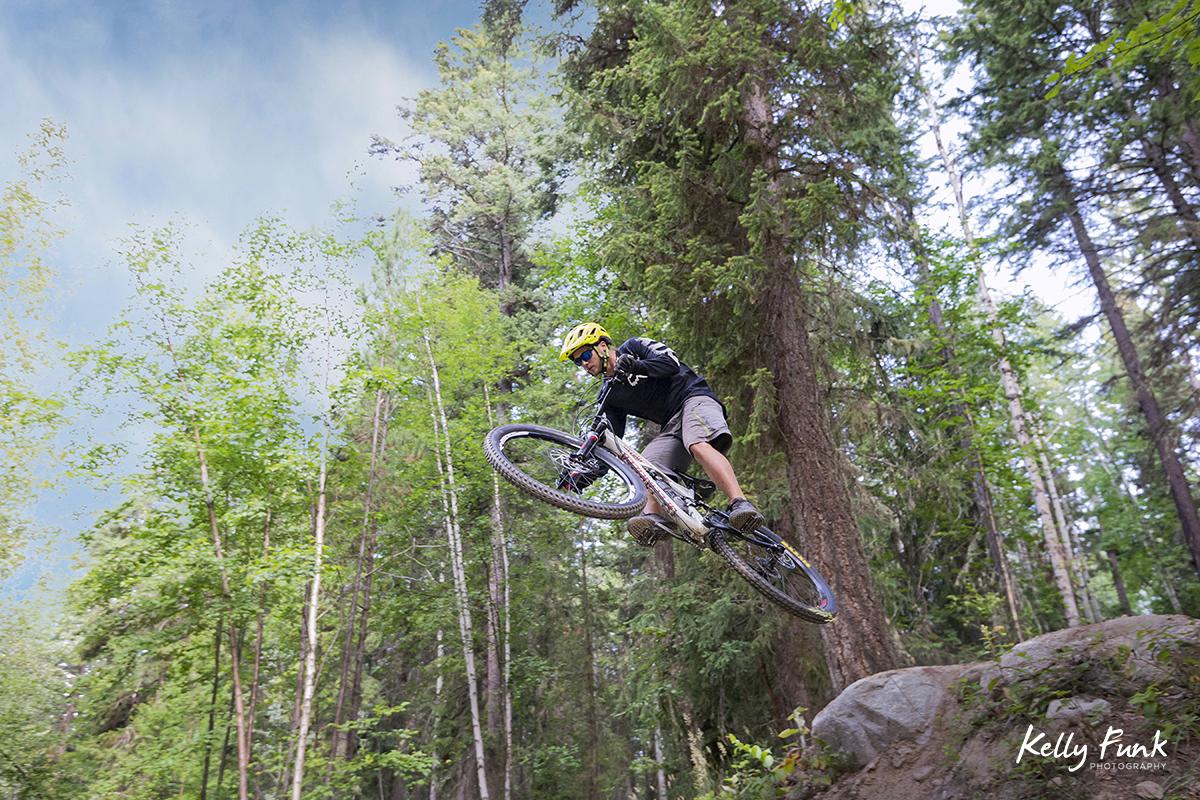 Mountain bike jumping at the bike park in Valemount, British Columbia, Canada