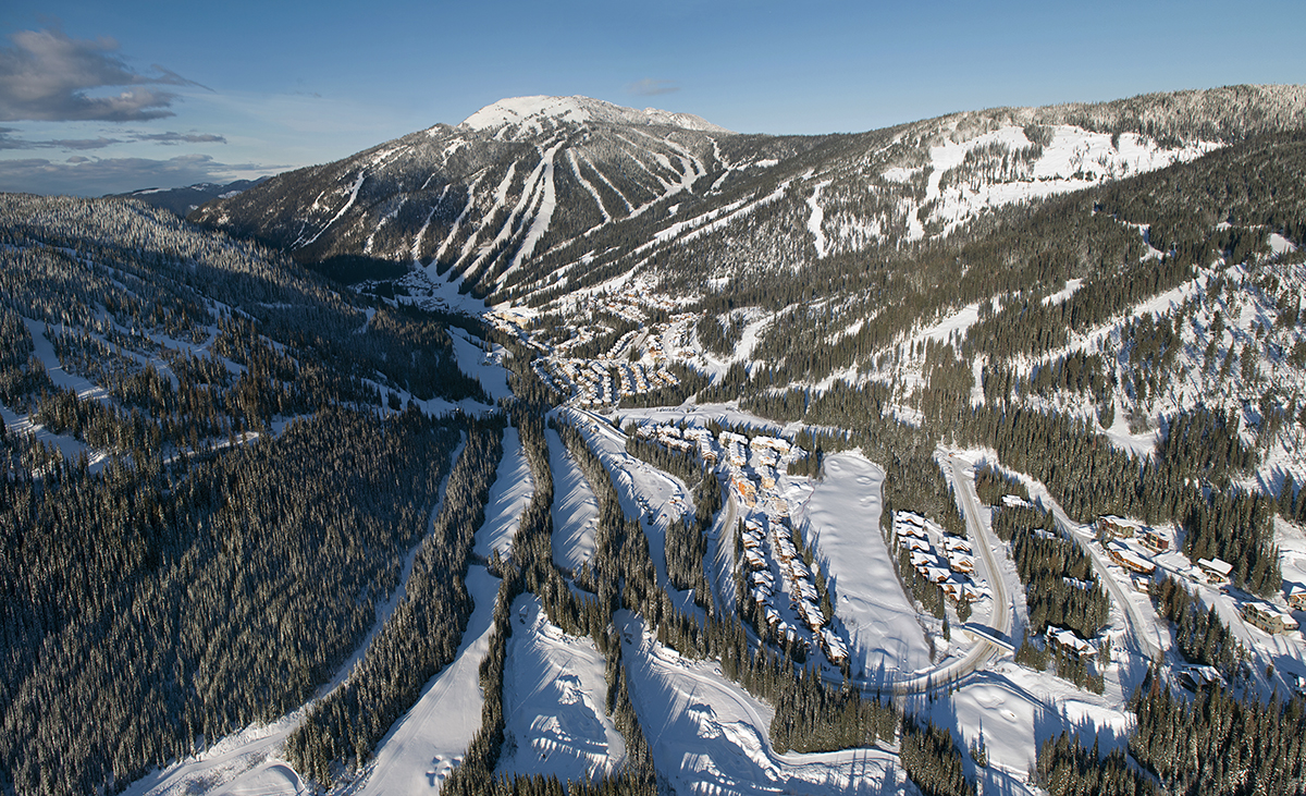 Aerial photograph in a helicopter of Mt. Morrissey, Tod mnt and the Village at Sun Peaks Resort during a tourism marketing shoot, British Columbia, Thompson Okanagan region, Canada