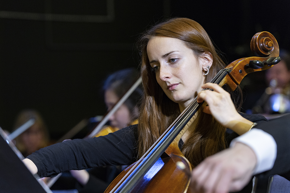 A female cello player with the Kamloops Symphony Orchestra, British Columbia, Canada