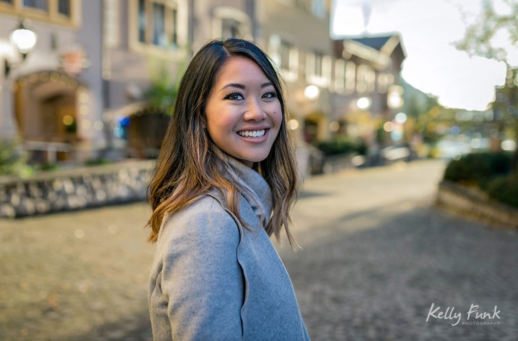 A beautiful woman poses for a portrait in the village of Sun Peaks Resort, British Columbia, Canada
