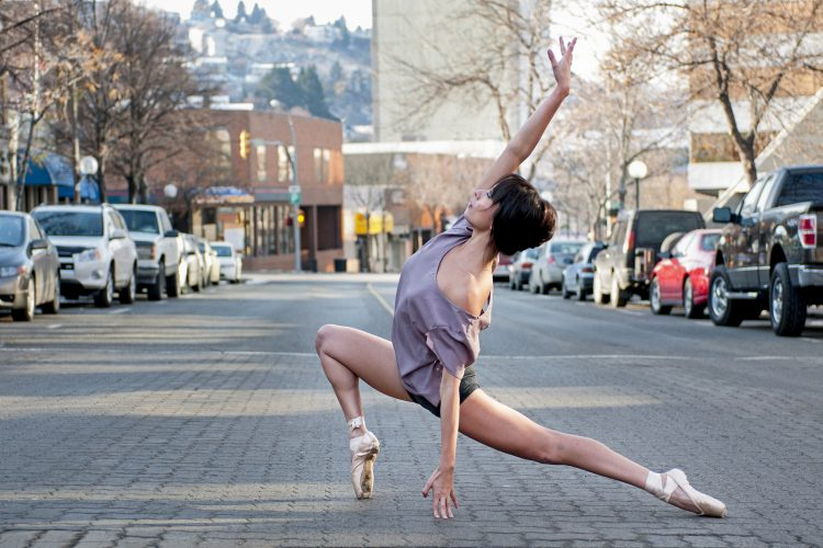 A beautiful young ballet dancer stops traffic with a pose in downtown Kamloops, British Columbia, Thompson Okanagan region, Canada