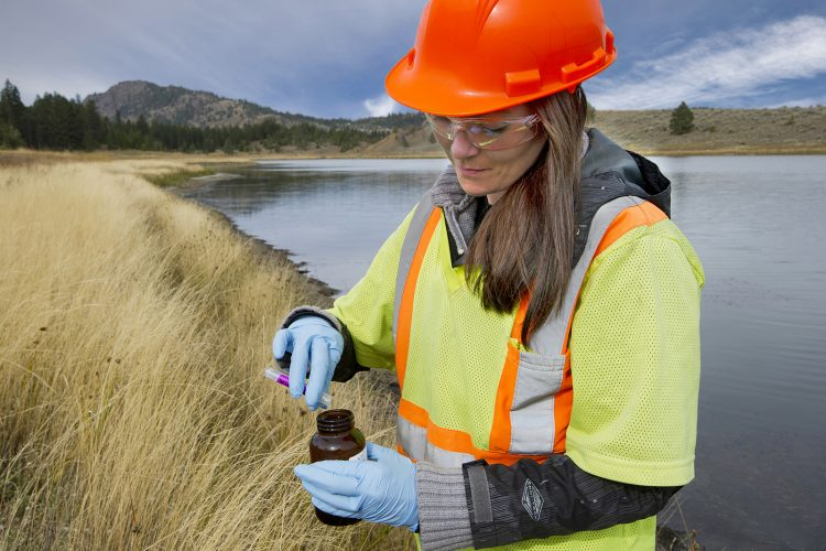 A biologist tests water samples near a mining operation, west of Kamloops, British Columbia, Thompson Okanagan region, Canada