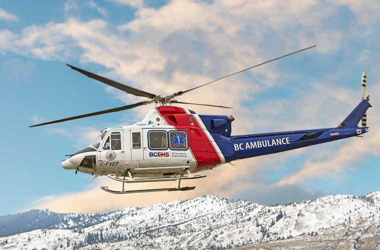 The BC Air Ambulance rescue helicopter takes off on a rescue mission to the Kootenay region from Kamloops, British Columbia, Canada