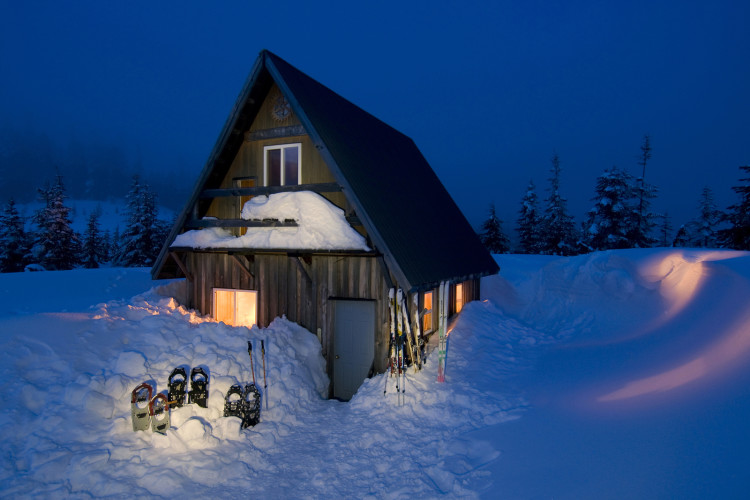 A quaint cabin makes for a beautiful scene at dusk while providing shelter for snowshoers and cross country skiiers near Powell River, British Columbia, Vancouver coast and mountain region, Canada