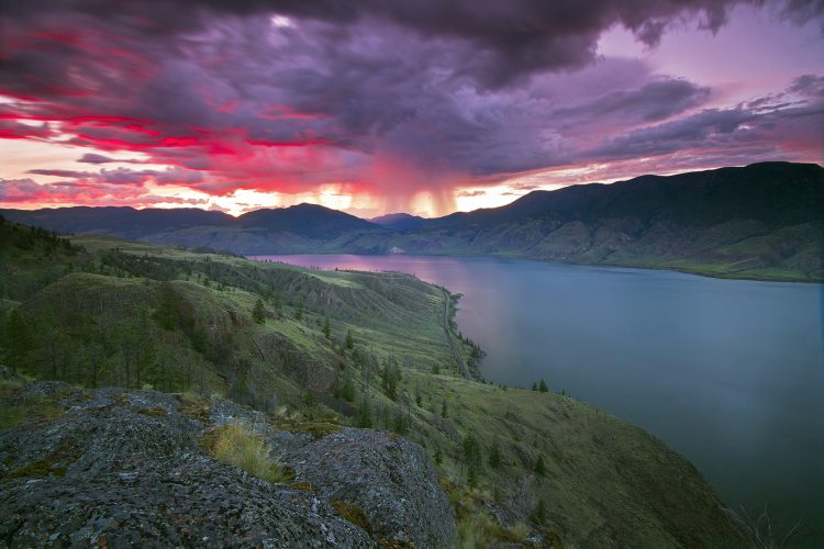 Sunset over Kamloops lake after a spring storm, west of Kamloops, Thompson Okanagan region, British Columbia, Canada
