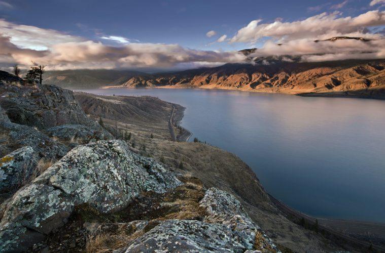 Rock outcroppings over Kamloops Lake at sunset, Thompson Okanagan region, BC, Canada