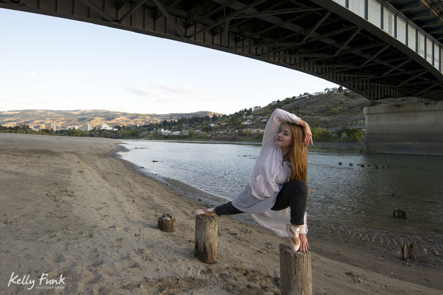 ballet dancer prepping for a photo shoot on the Thompson river, Kamloops, BC, Canada