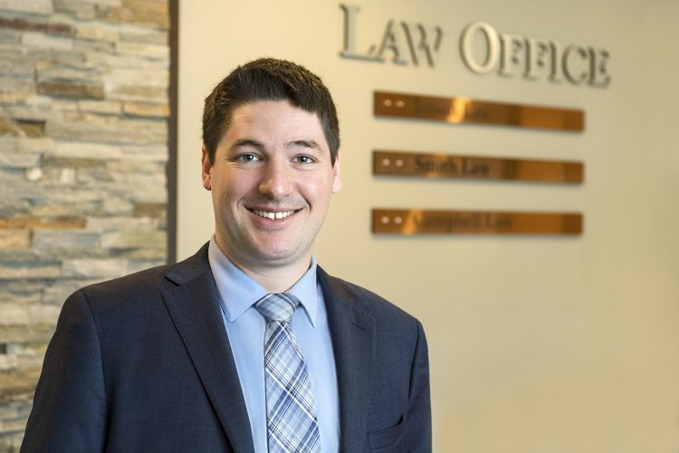 Portrait of a young lawyer at the Law offices of Jensen Law, Kamloops, British Columbia, Thompson Okanagan region, Canada