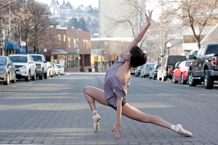 A female ballerina poses on Victoria street in Kamloops, Thompson Okanagan region, British Columbia Canada,  Nikon Canada