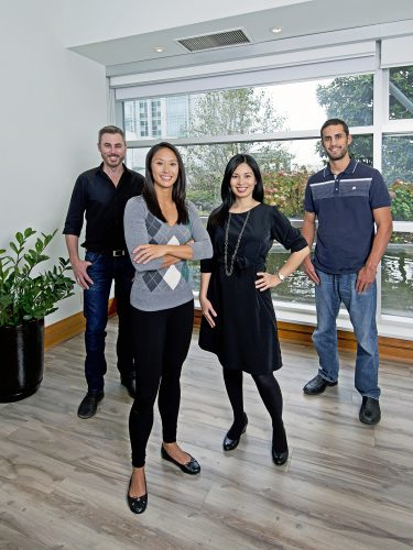 Staff and doctors at a chiropractic clinic in Vancouver, British Columbia, Canada