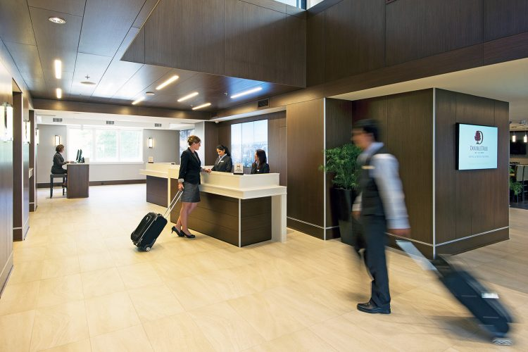 A porter moves through the lobby and reception area of the Doubletree Hilton, Victoria, British Columbia, Vancouver Coast and mountain, region, Canada