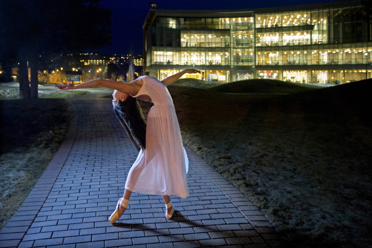 A female ballerina poses at Thompson Rivers University in Kamloops, Thompson Okanagan region, British Columbia Canada,