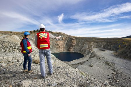 Mining consultants talk about logistics at a mine site near Kamloops, British Columbia, Canada