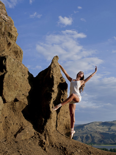 A female ballet dancer poses on hoodoos just West of Kamloops, Thompson Okanagan region, British Columbia Canada,