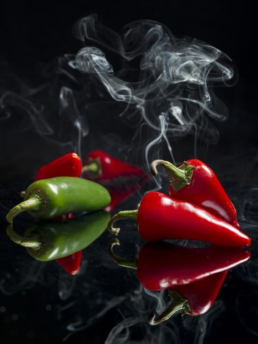 conceptual image of hot peppers with smoke during an agency stock shoot in Kamloops, Thompson Okanagan region, British Columbia, Canada