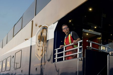 A professional maintenance person checks the lines on the Rocky Mountaineer rail tour, British Columbia, Canada