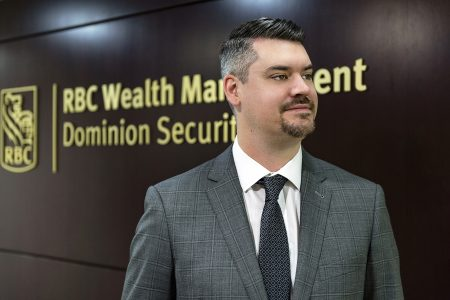 Portrait of a corporate businessman working at RBC and showcasing their logo, Kamloops, British Columbia, Canada