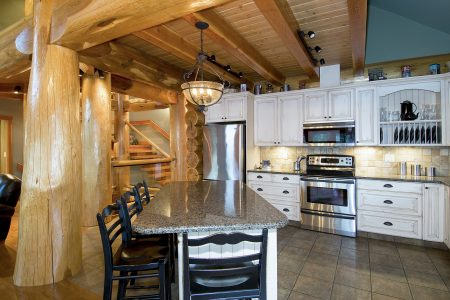 Kitchen of a stunning log home in the Thompson Okanagan region of British Columbia, Canada