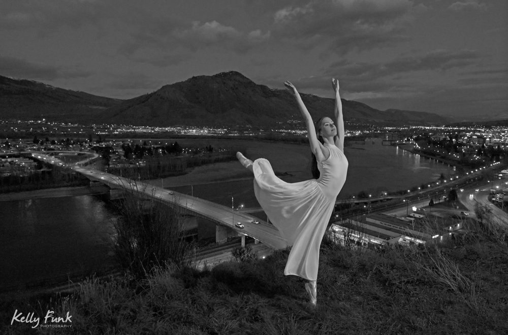 A beautiful, young ballerina dancer poses over Kamloops, British Columbia, in the Thompson Okanagan region, Canada
