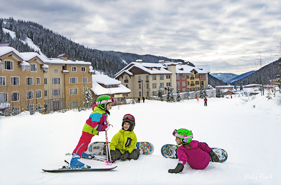 Kids relax and laugh during a break of skiing and snow boarding at Sun Peaks resort, near Kamloops, British Columbia, Canada