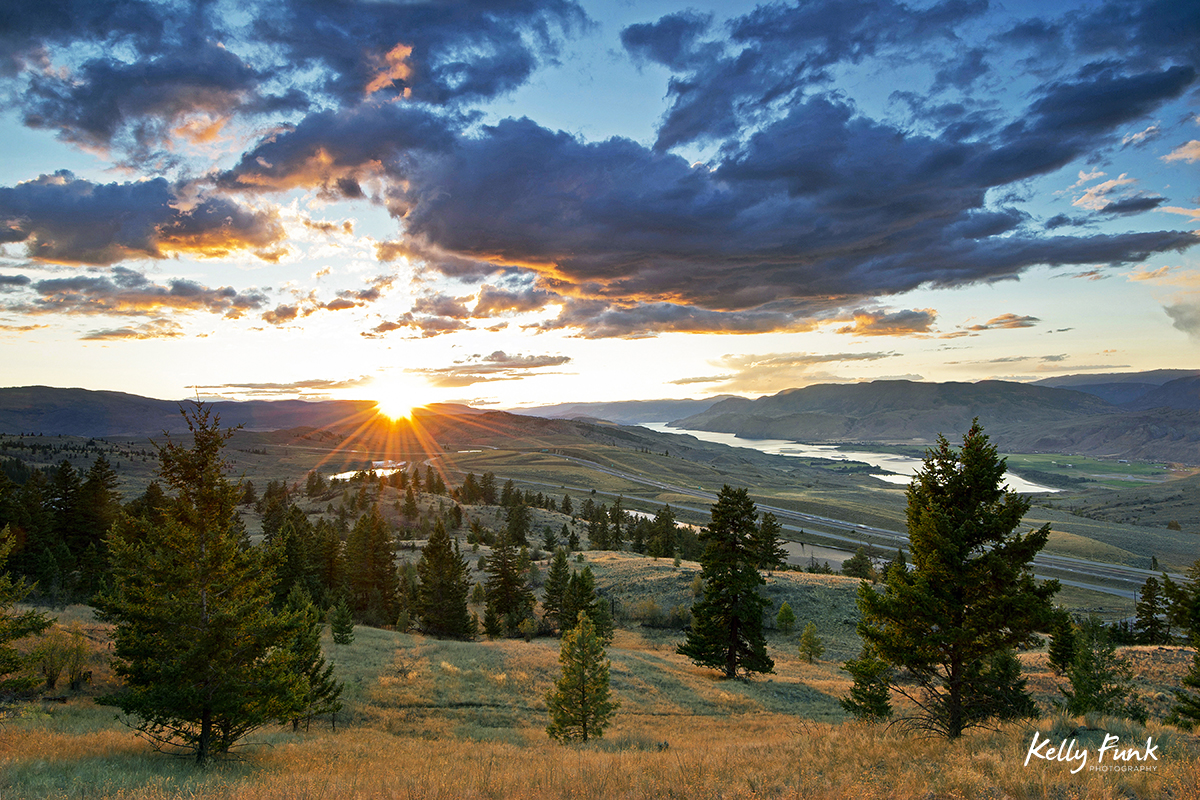 Sunset over highway 5 west of Kamloops in the grasslands, British Columbia, Canada