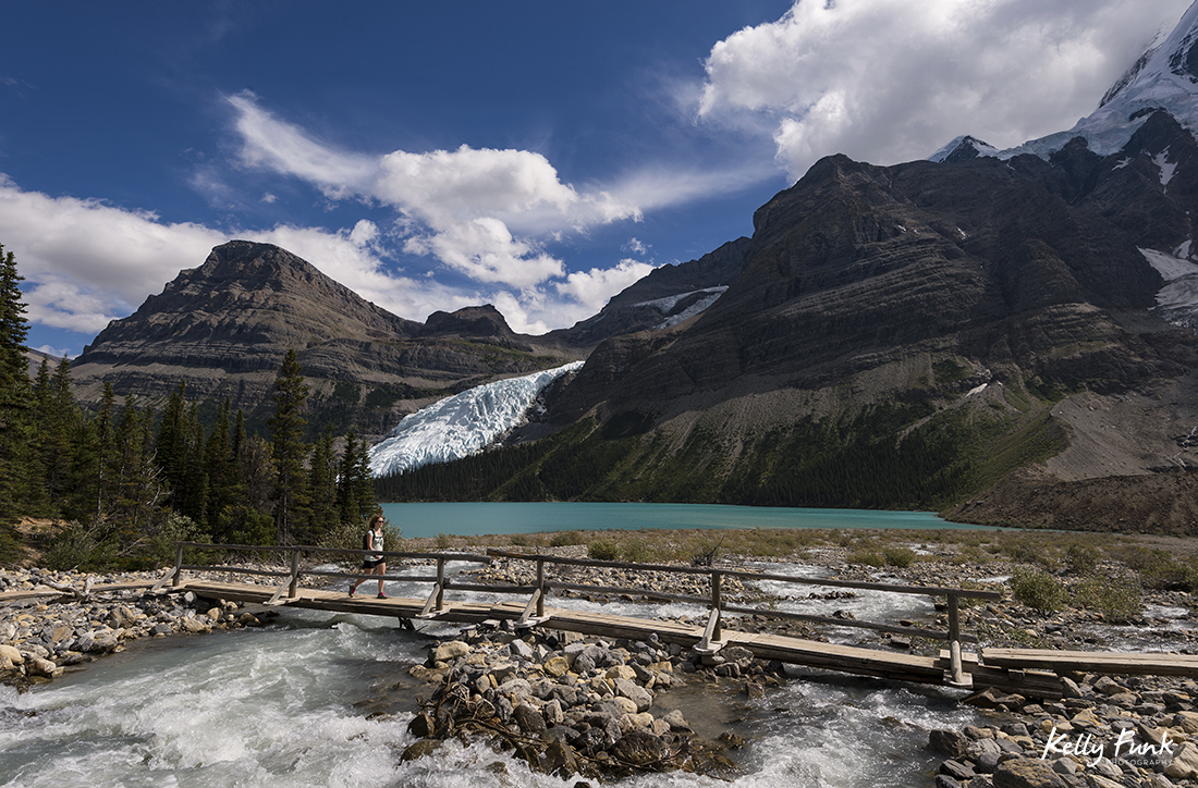 A hiker crosses the Robson River at Berg lake, Mt. Robson Provincial Park, Canadian Rockies, British Columbia