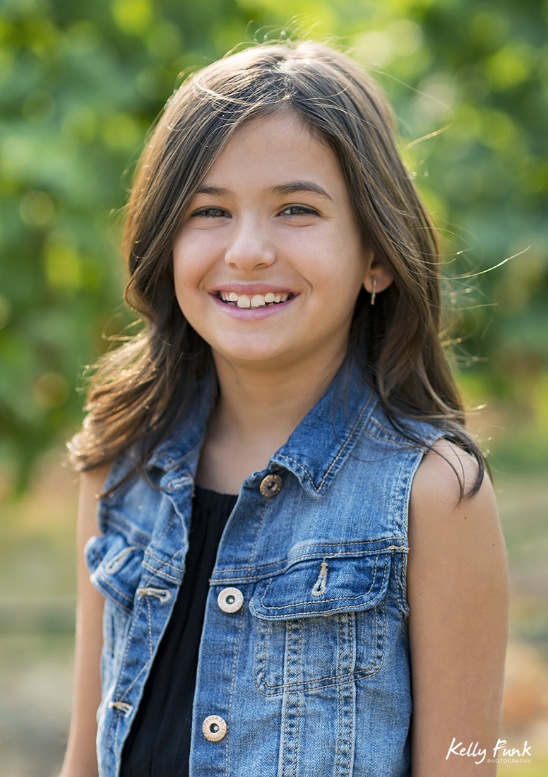 beautiful young girl at the vineyard of Kelowna's Indigenous World Winery during a commercial shoot, British Columbia, Canada