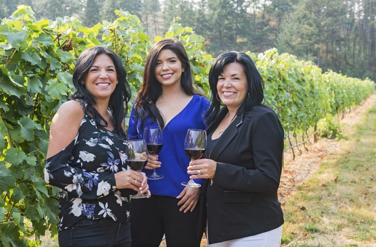Mother and daughters at the vineyard of Kelowna's Indigenous World Winery during a commercial shoot, British Columbia, Canada