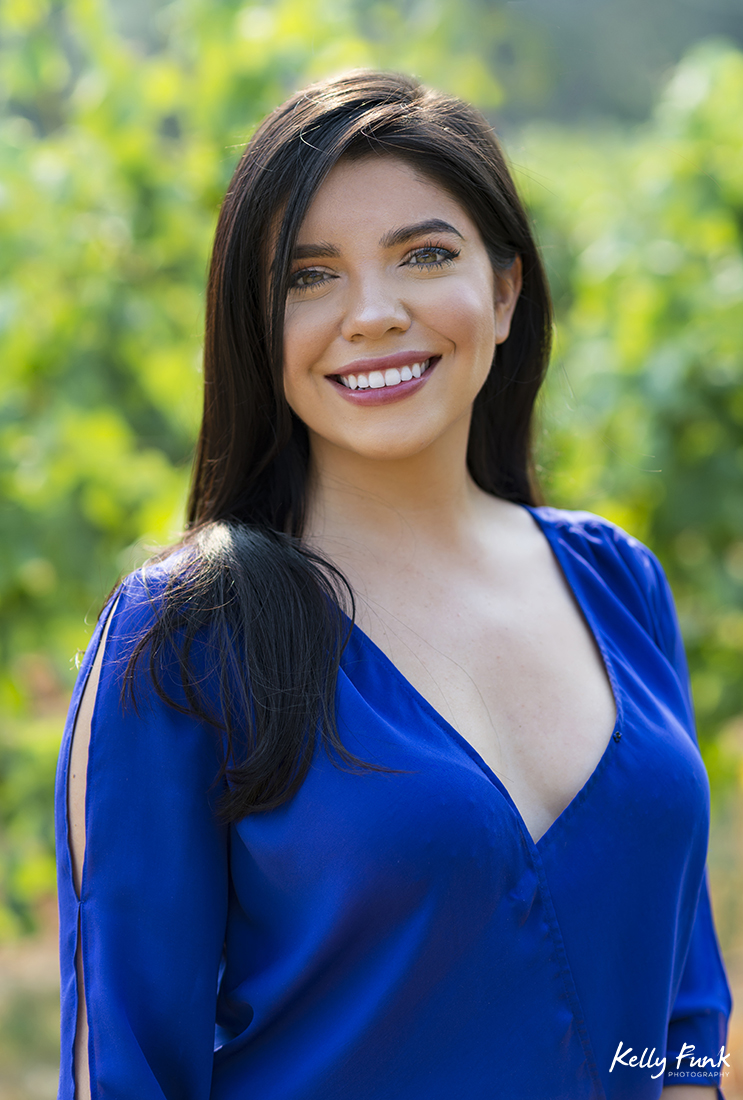 Beautiful young lady at the vineyard of Kelowna's Indigenous World Winery during a commercial shoot, British Columbia, Canada
