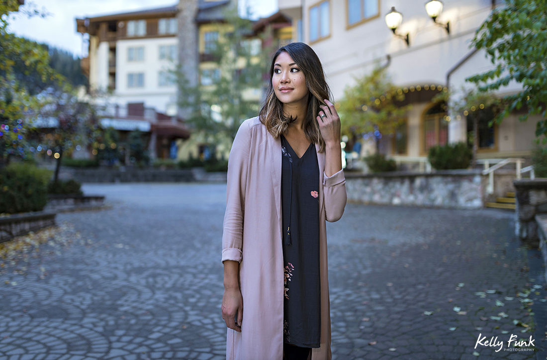 A beautiful young woman poses during a fall fashion and stylized portrait shoot in the village of Sun Peaks, British Columbia, Thompson Okanagan region, Canada