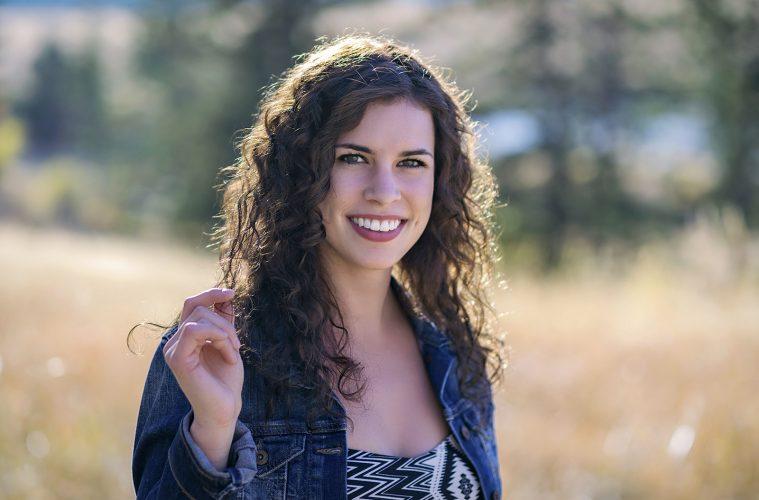 Stylized shoot of a young, beautiful woman in the fall, Kamloops, Thompson Okanagan region, British Columbia, Canada