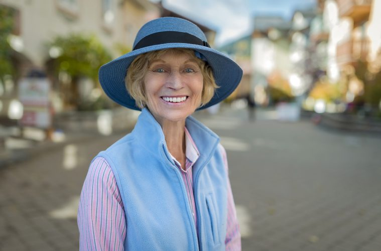 A fashionable lady stops for a portrait in the village of Sun Peaks, british columbia, Canada, Thompson Okanagan region