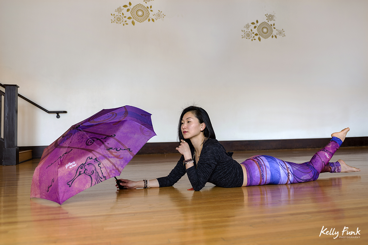 A beautiful woman poses during a commercial fashion shoot for lifestyle active wear at the Yoga Loft, Kamloops, British Columbia, Canada