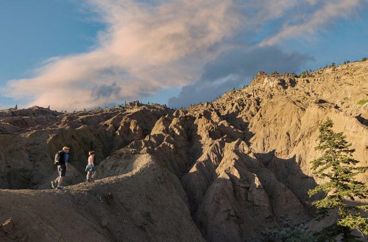 Hikers enjoying sunset in the desert region of British Columbia, Thompson Okanagan region, Canada