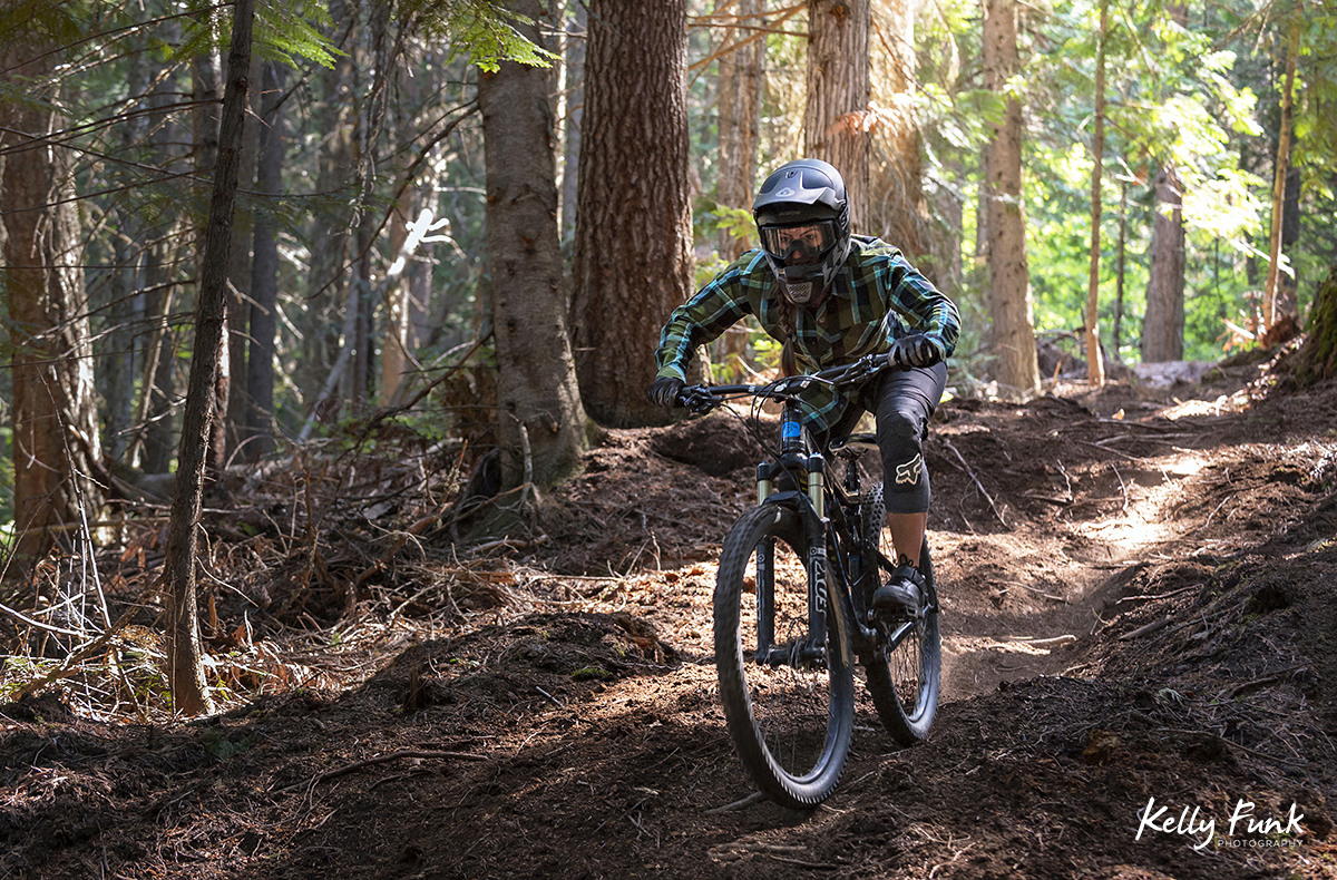 A female rides single track at the bike park in Valemount, British Columbia, Canada