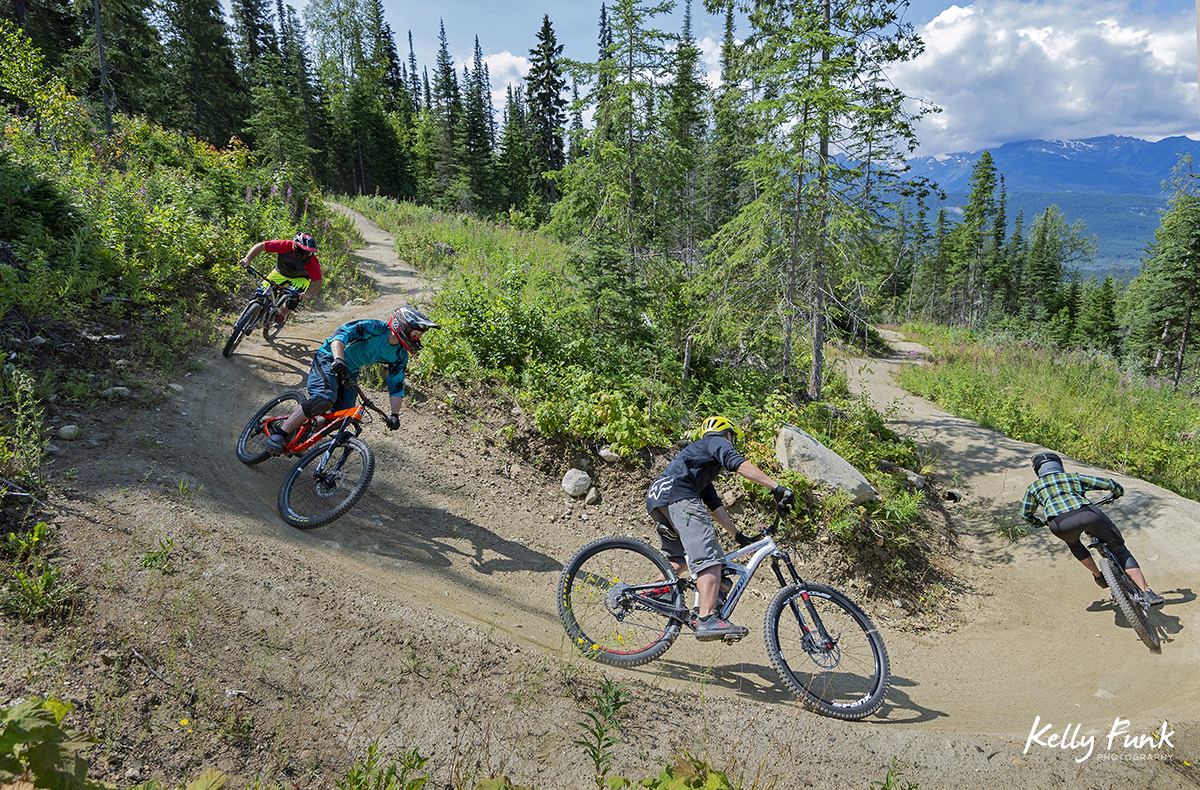 A group of riders tackle single track at the bike park in Valemount, British Columbia, Canada