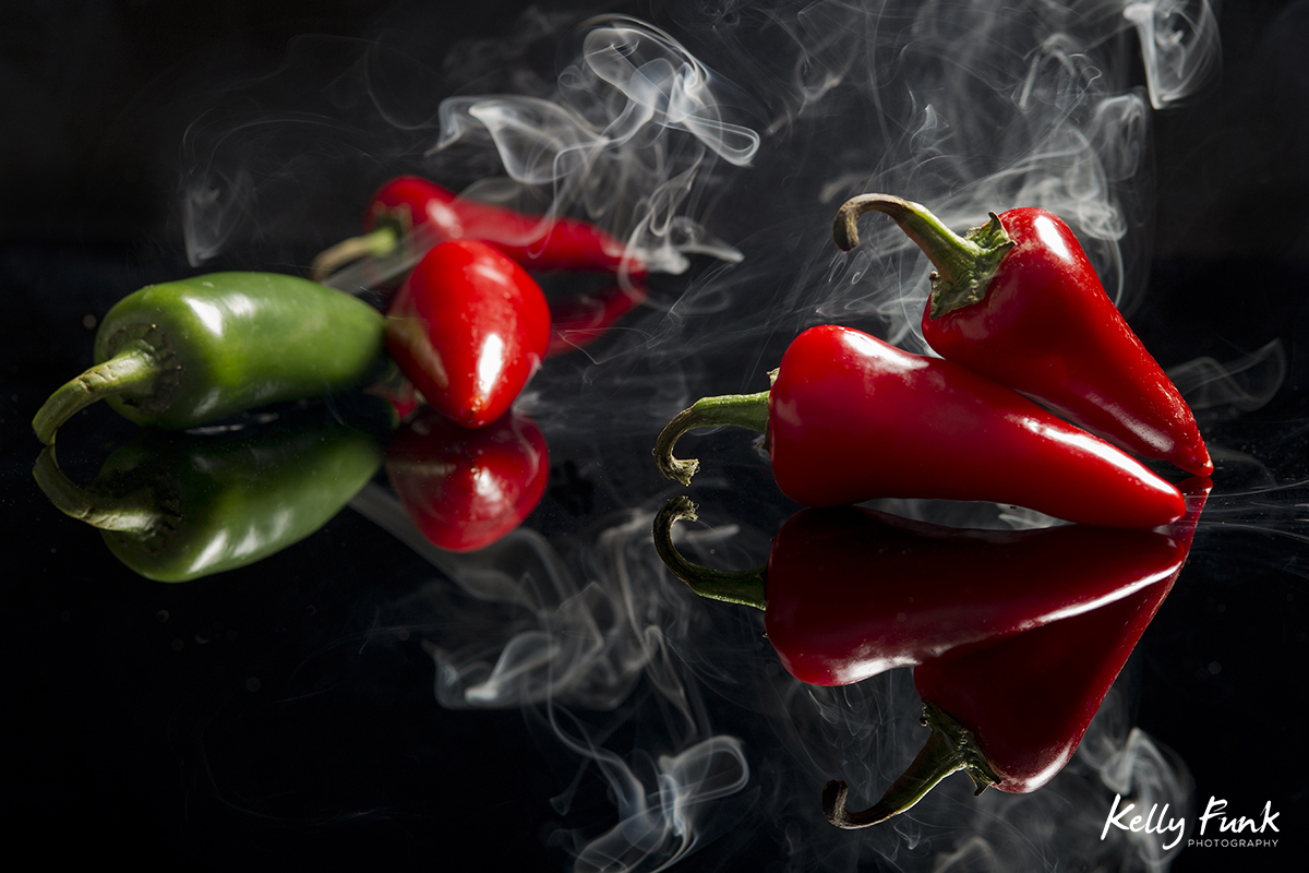 Smoking peppers are photographed during a commercial photography shoot.