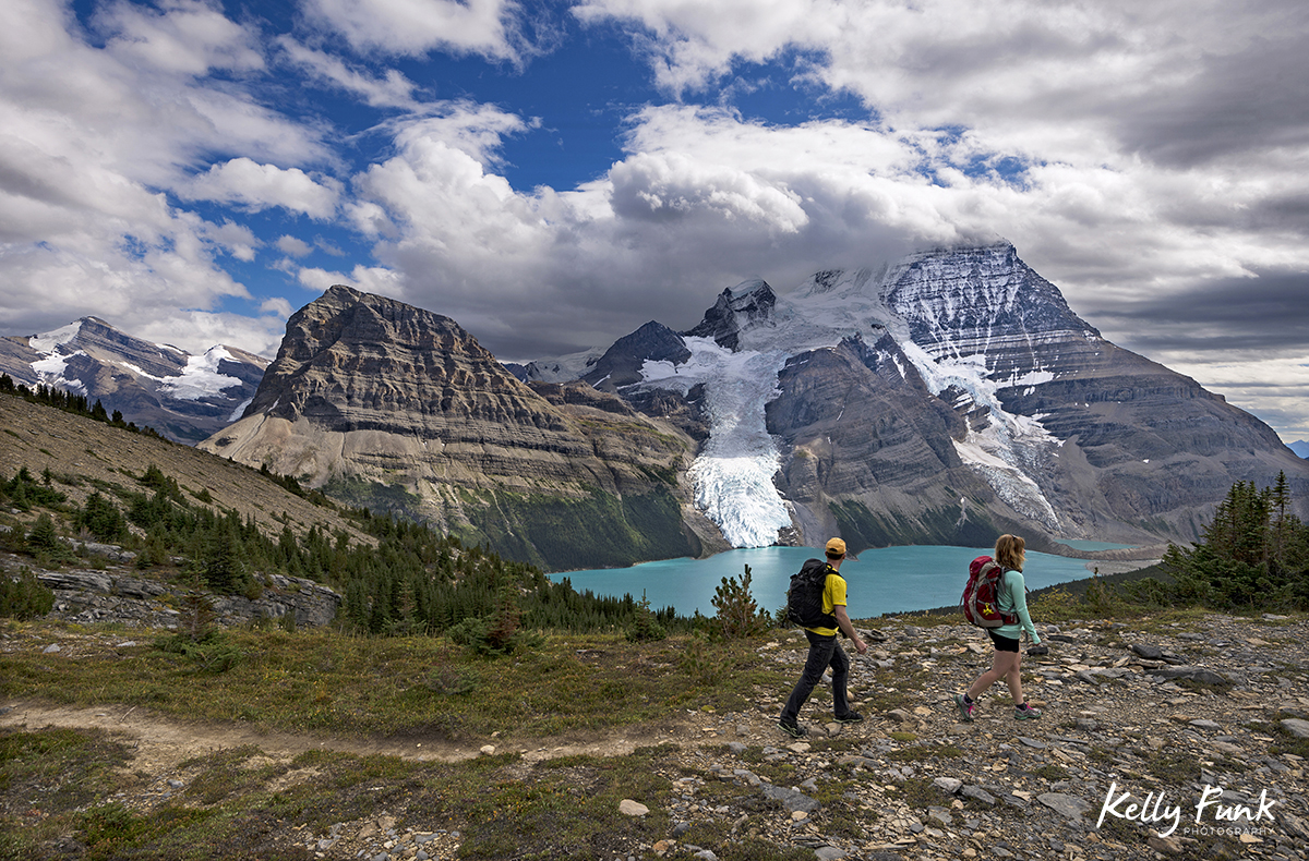 Two hikers enjoy the trail overlooking Berg Lake and Mt. Robson Provincial Park, British Columbia, Canada