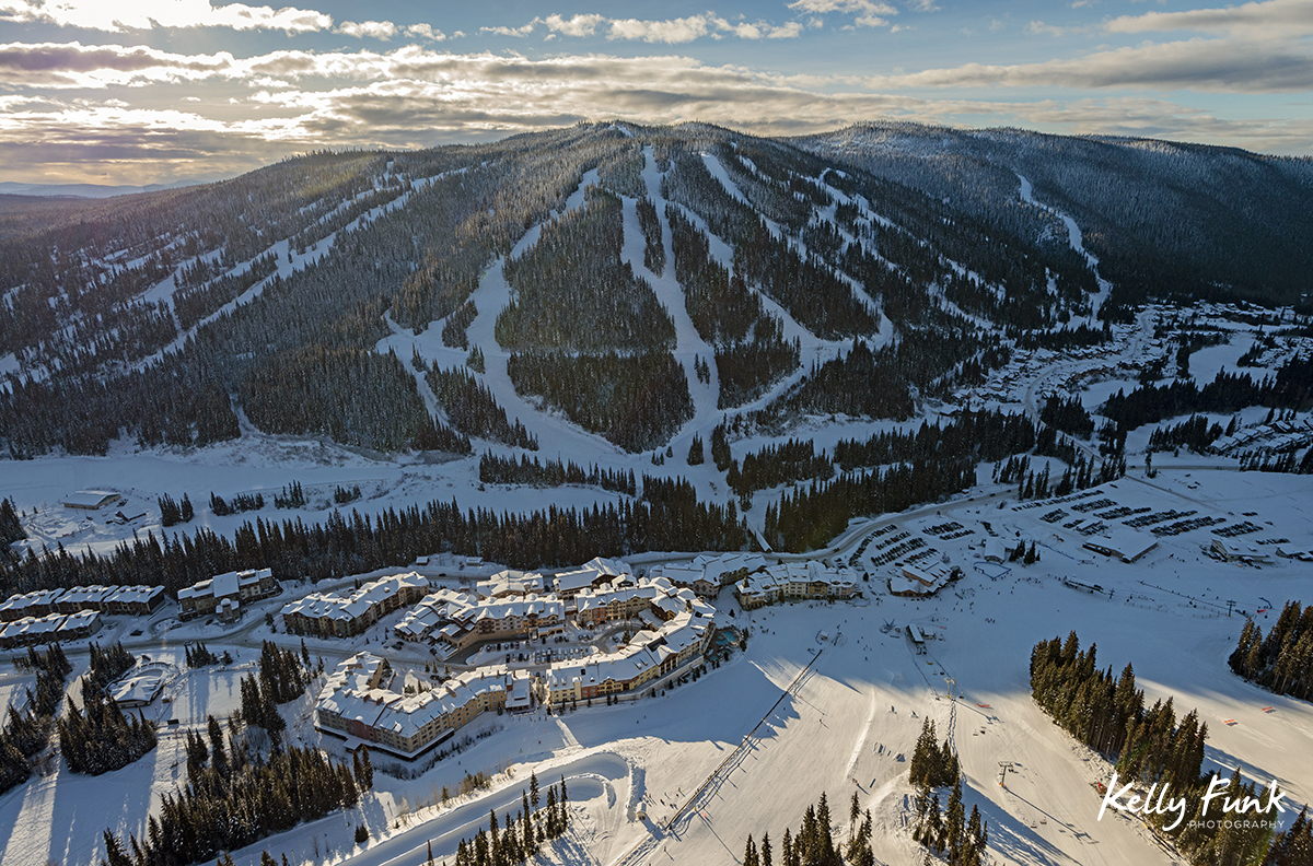 Aerial photograph in a helicopter of Mt. Morrissey and the Village at Sun Peaks Resort during a tourism marketing shoot, British Columbia, Thompson Okanagan region, Canada