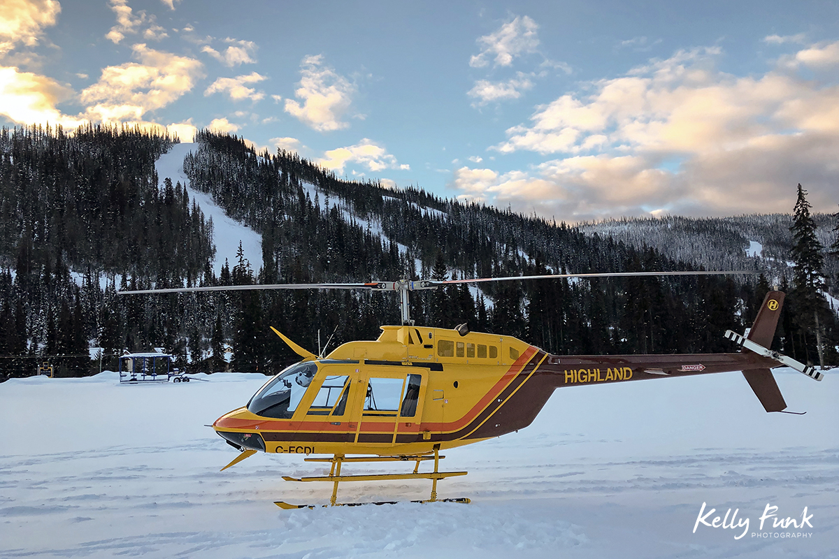 Highland Helicopters waiting to take myself and Sun Peaks employees on a 2 hour flight for tourism imagery at Sun Peaks Resort, Thompson Okanagan region, British Columbia, Canada