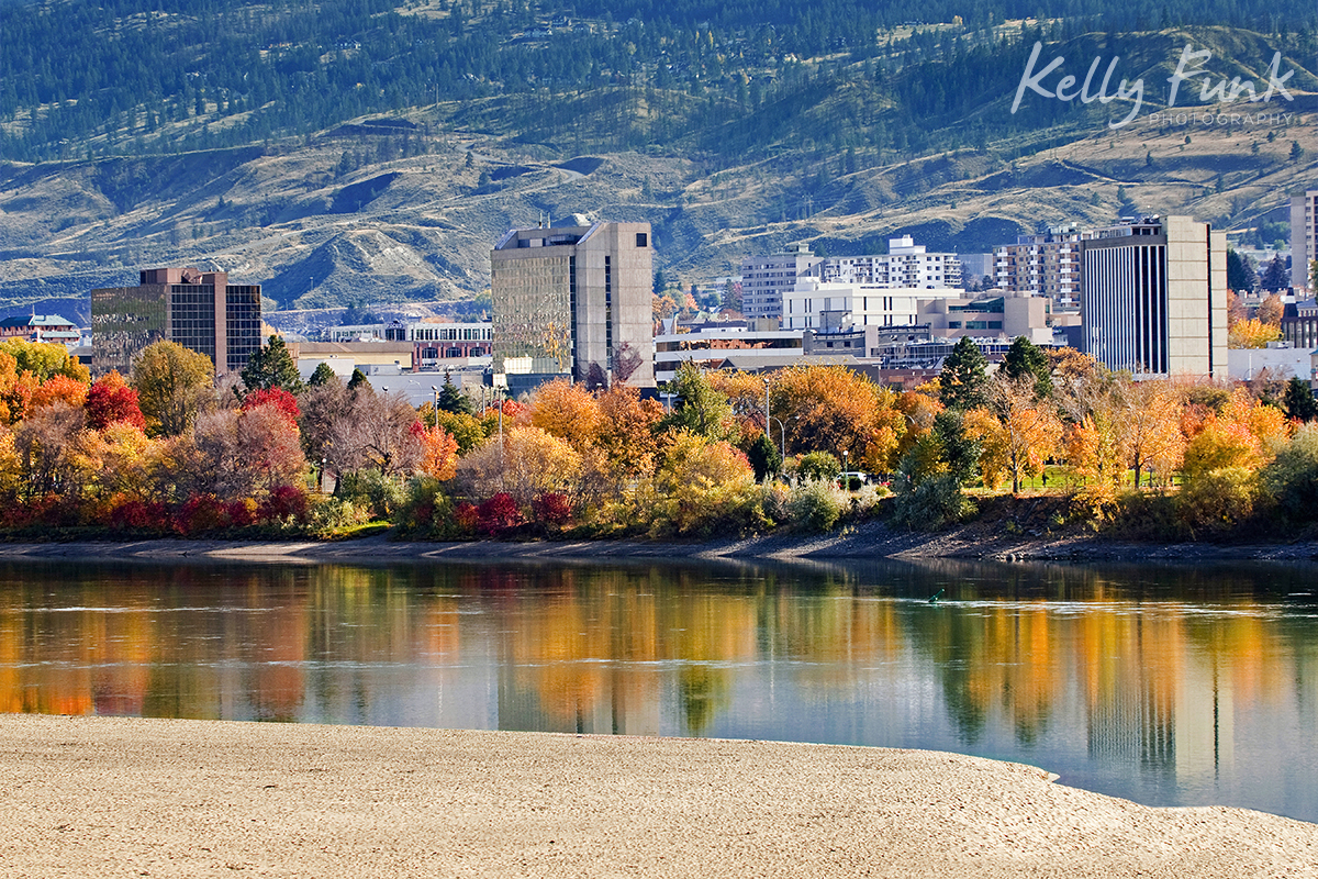 Kamloops city is reflected in the Thompson river on a beautiful fall day, British Columbia, Canada