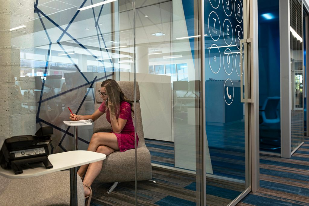A KPMG worker takes a call inside their telephone room at the office in Kamloops, British Columbia, Canada