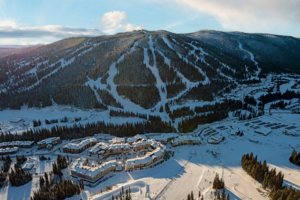 Drone of the ski resort of Sun Peaks, looking south over the village and Mt. Morrisey, British Columbia, Canada